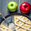 Apples and freshly baked apple pie on old blue table — Stock Photo #21857995