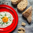 Egg served with parsley and bread — Stock Photo