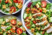 Three healthy salads with fresh vegetables — Stock Photo