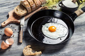 Closeup of fggs for breakfast fried on a pan — Stock Photo