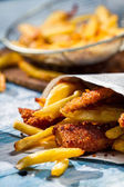 Homemade Fish & Chips served in the newspaper — Stock Photo