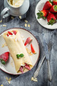 Fresh strawberry pancakes with mint leaf — Stock Photo