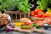 Fresh vegetables as ingredients for homemade hamburger — Stock Photo