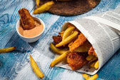 Closeup of homemade Fish & Chips in newspaper — Stock Photo