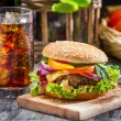 Closeup of homemade hamburger and a Coke with ice — Stock Photo #22951038