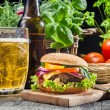 Homemade burger and a cold beer - Stock Photo