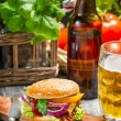 Homemad hamburger and a cold beer - Stock Photo