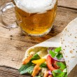 Tasty kebabs and cold beer — Stock Photo