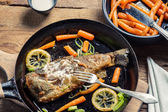 Fish served and eaten straight from the pan — Stock Photo