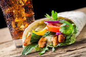 Closeup of kebab with fresh vegetables and chicken on black back — Stock Photo