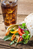 Kebab served with cold cola — Stock Photo