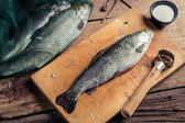 Preparing trout for dinner in the countryside — Stock Photo