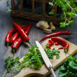 Fresh herbs and spices in old basket — Stock Photo