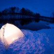 Warm accommodation in the cold winter night - Stock Photo