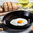 Homemade bread and fresh fried egg — Stock Photo