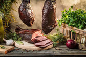 Freshly smoked ham in homemade smokehouse — Stock Photo