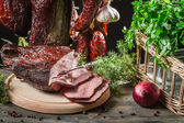Fresh piece of ham in a homemade smokehouse — Stock Photo