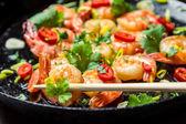 Closeu of tasting fried shrimp with chopsticks — Stock Photo