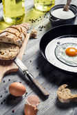 Egg served with bread on a pan in countryside — Stock Photo