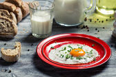 Fried eggs and homemade bread for breakfast — Stock Photo