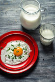 Country style simple breakfast with eggs and milk — Stock Photo