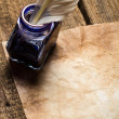 Ancient scrolls and old envelope with blue inkwell - Stockfoto