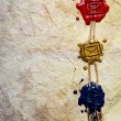 Closeup of three envelope symbol imprinted in sealing wax - 图库照片