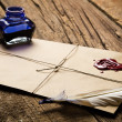 Ancient scrolls and old envelope with blue inkwell - Photo