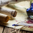 Ancient scrolls and old envelope with blue inkwell - Foto Stock