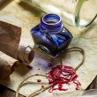 Ancient scrolls and old envelope with blue inkwell - Stok fotoraf