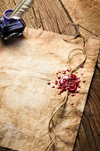 Ancient scrolls and old envelope with blue inkwell — Stock Photo