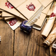 Ancient scrolls and old envelope with blue inkwell - Stok fotoğraf