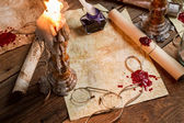 Closeup of table filled with old messages and candles — Stock Photo