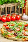 Closeup of homemade pizza with parma ham — Stock Photo