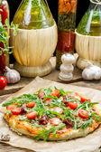 Homemade pizza with parma ham — Stock Photo