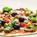 Prepared pizza before baking — Stock Photo