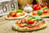 Freshly baked mini pizzas — Stock Photo
