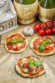 Fresh ingredients for a mini pizza with mushrooms — Stock Photo