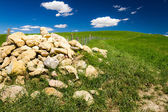 Pile of stones in Tuscany field at summer, Italy — Stock Photo