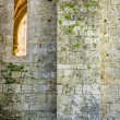 Medieval wall of white stone with a high window — Stock Photo