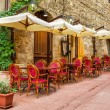 Stock Photo: Small cafe on corner of old city in Italy