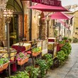 Vintage cafe on the corner of the old city in Italy — Stock Photo