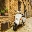 Stock Photo: Old Vespscooter on street in Italy