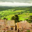 View of the red roofs and green valley in Volterra, Italy — Stock Photo