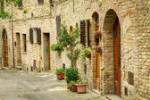 Vintage street decorated with flowers, Italy — Stock Photo