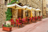 Small cafe on the corner of the old city in Italy — Stock Photo