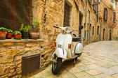 Old Vespa scooter on the street in Italy — Stock Photo