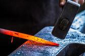 Blacksmith at work in anvil — Stock Photo