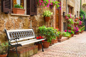 Beautiful street decorated with flowers in Italy — Stock Photo