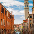 Ancient buildings on a canal in Venice — Stock Photo